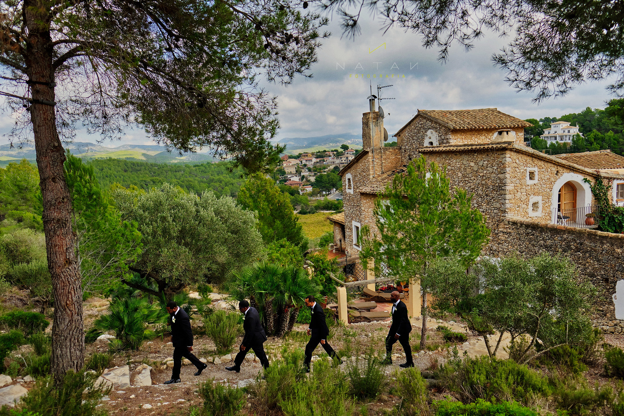 Groom and best men coming to the ceremony, in Almiral de la Font, Sitges