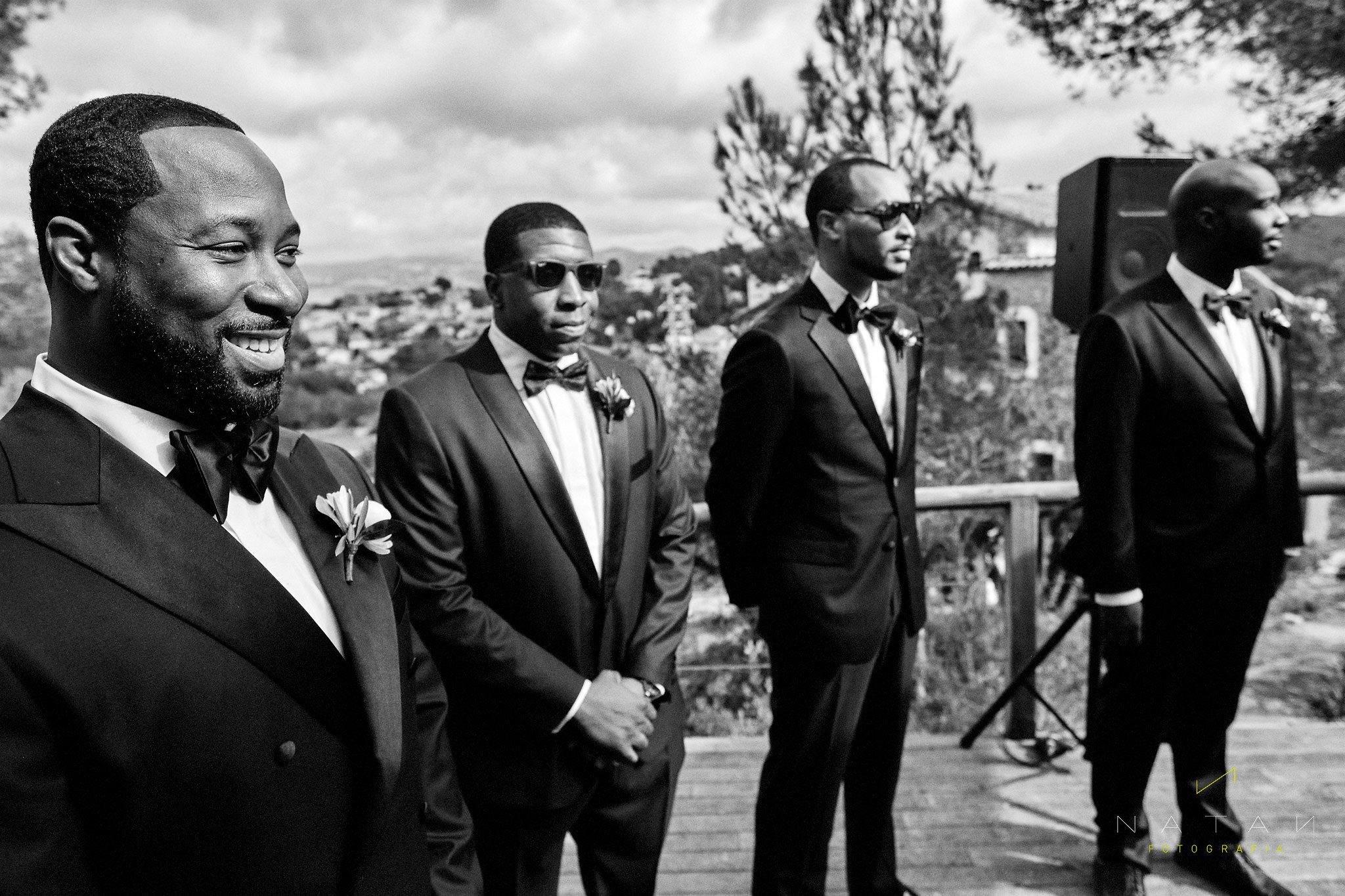 Groom & best men happy seeing bride arriving at ceremony
